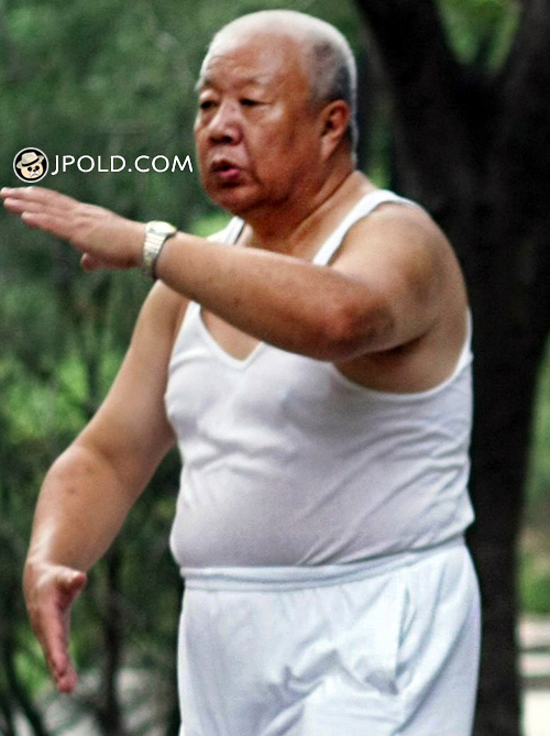 Fat white hair old man in white clothes was exercising in the park