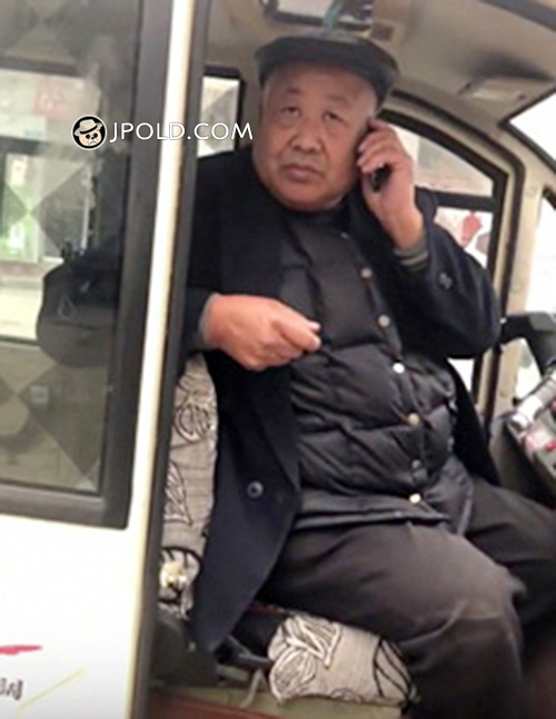 Black coat old man was calling in the car