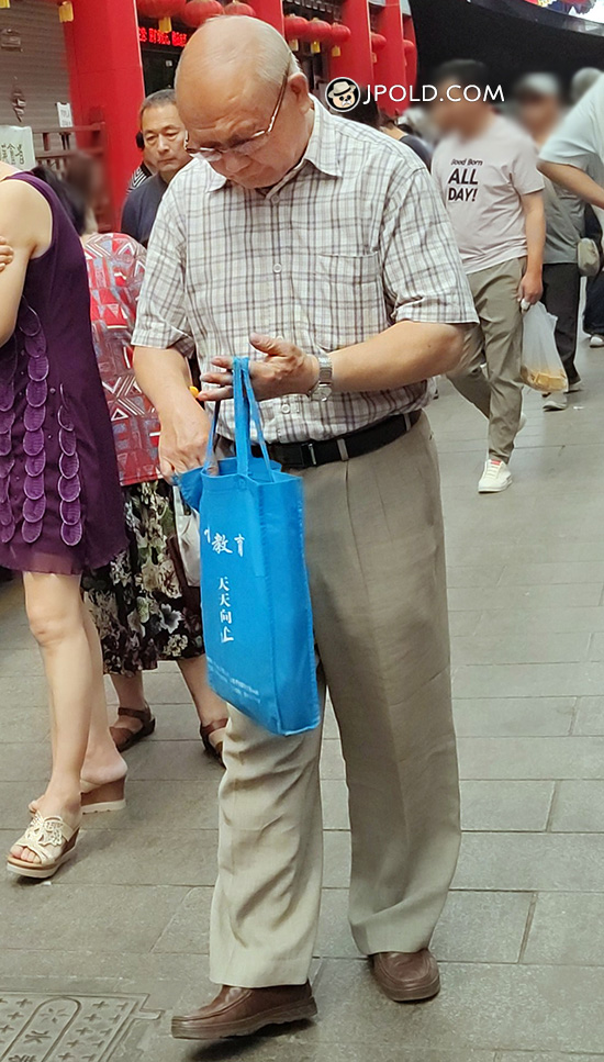 Bald head glasses old man in plaid shirt went shopping
