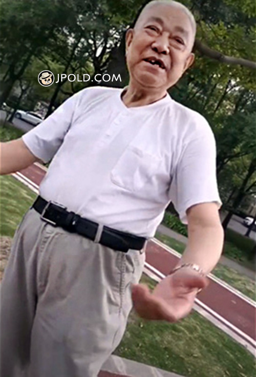 White undershirt old man walked in the park