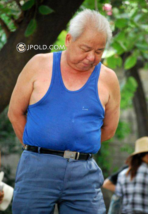 White hair old man in blue clothes in the park