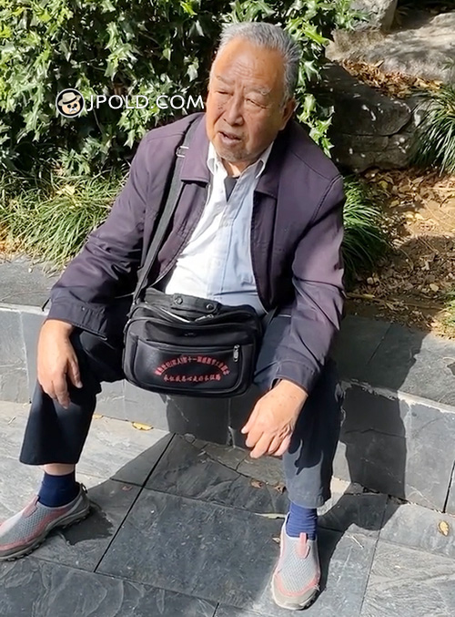 Grey jacket old man sat in the park Video The 1 Picture