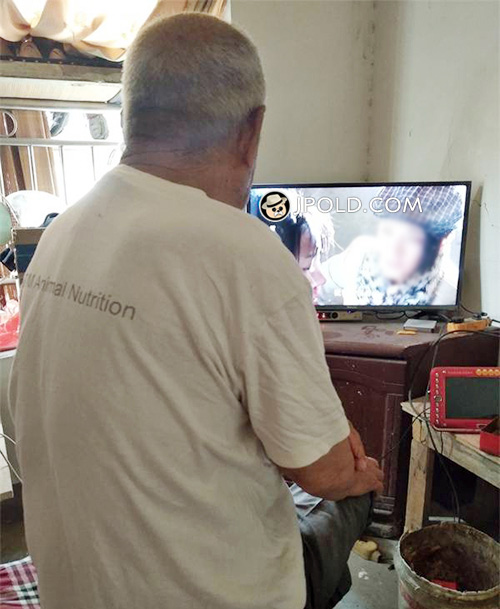 Grandpa was watching TV in the bedroom