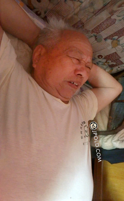 Fat white hair grandpa was lying on his bed
