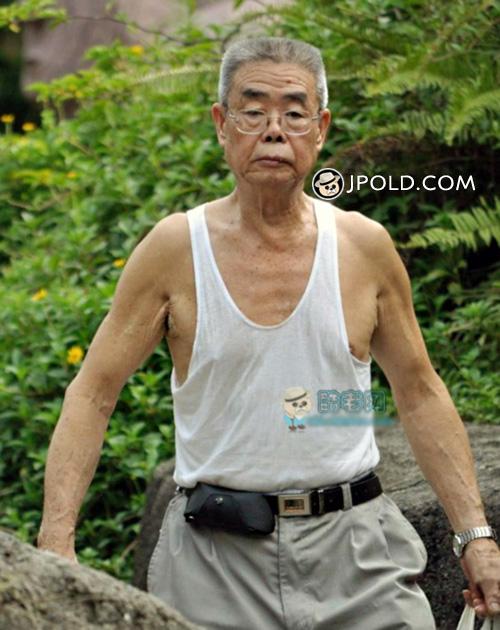 Thin old man in white vest undershirt walked in the park