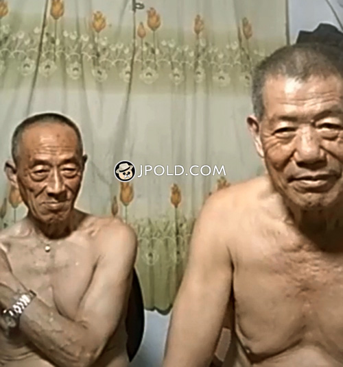 Two old men were watching TV at home