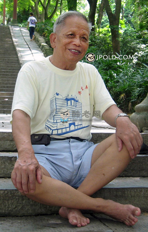 Old man in yellow undershirt and blue pants rest on the stone stairs