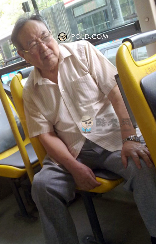 Glasses old man in white shirt and blue trousers by bus