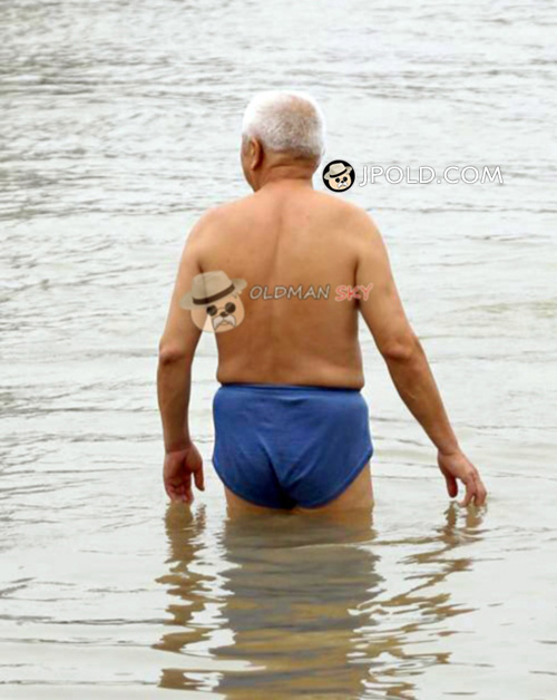 White hair old man in a blue underwear went swimming