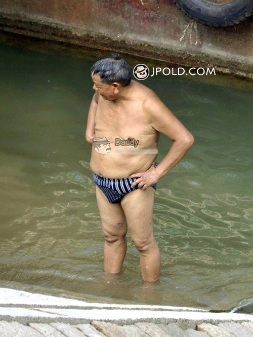 Swimming old daddy in a underwear walked out of river