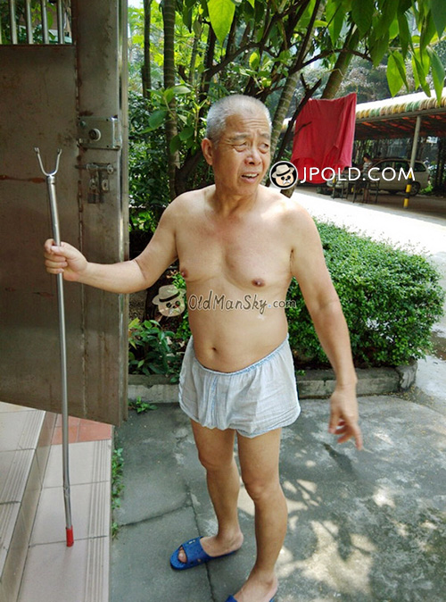 White hair old man in a white underwear hang the clothes