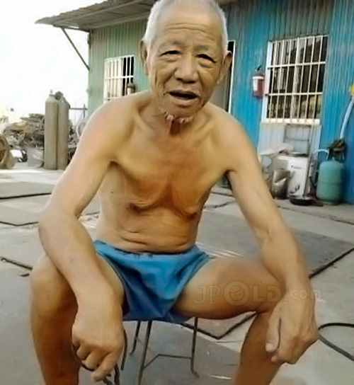 Old man in a blue boxer underwear at home