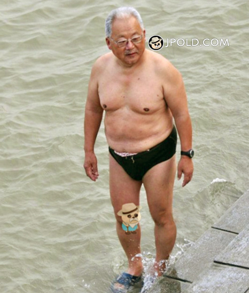 Glasses old man in a black underwear stood by the river