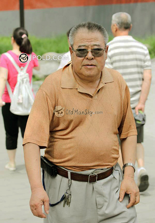 Sunglasses old daddy in orange polo shirt walked