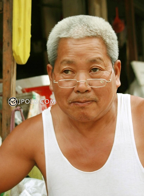 White hair glasses old man fixed shoes in the street