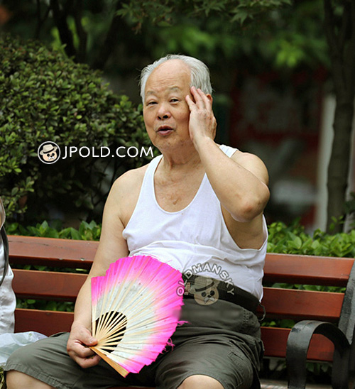 White hair old man in white vest undershirt sat on the bench