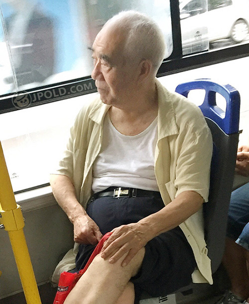 White hair old man by bus