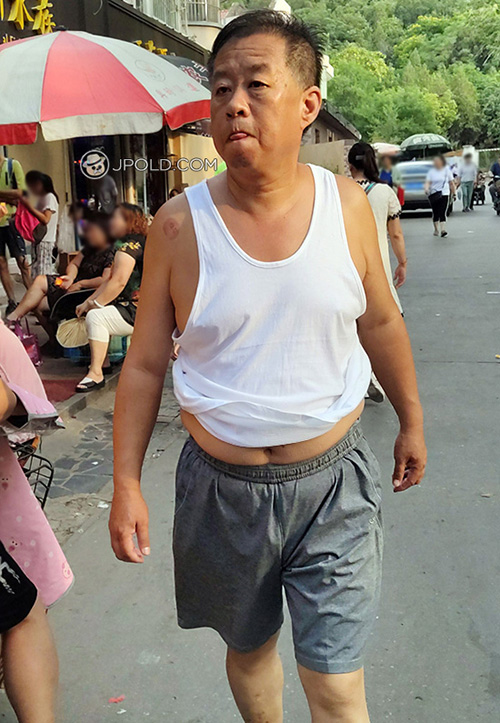 Old daddy in white vest undershirt and grey middle pants went shopping