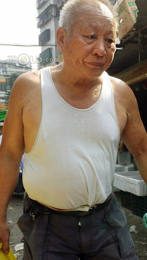 Old man in white vest undershirt and grey middle pants shopped