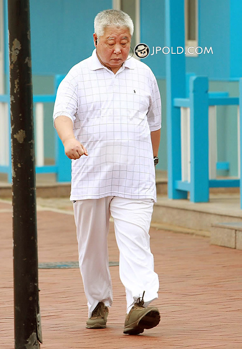 White hair old man in white clothes walked