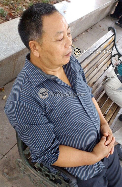 Old daddy in brown clothes took a rest on a bench