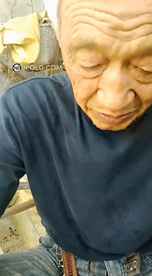 Old man played cellphone and talked