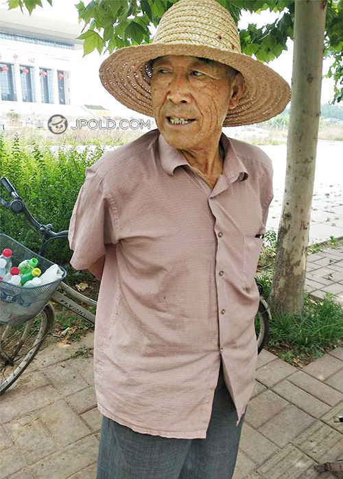 Old man wore a bamboo hat show his belly