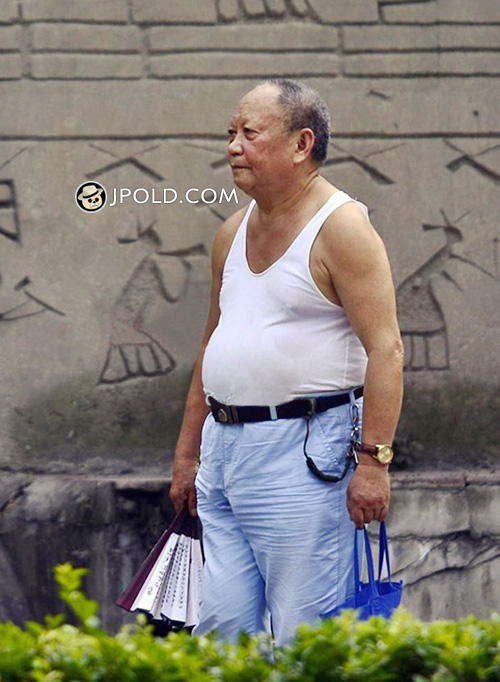 Old daddy in white vest undershirt and light blue trouser walked