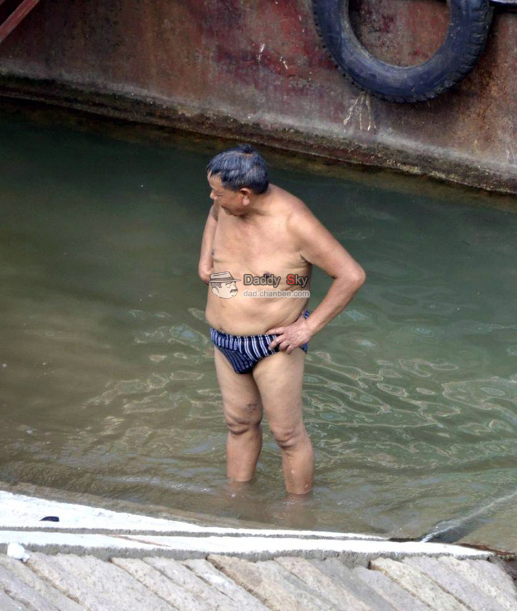 Sturdy daddy swimming in river