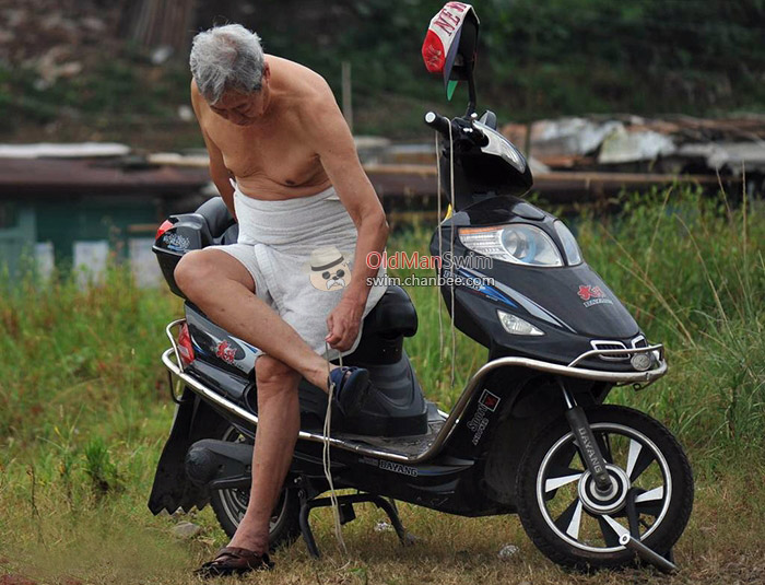 White hair swimming old man with an electric motorcycle