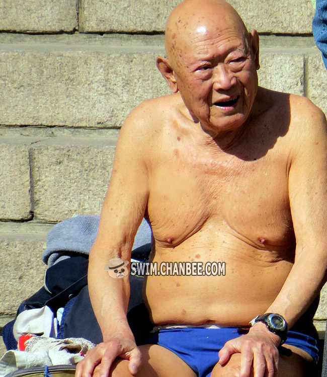 Old grandpa undressing ready to swimming
