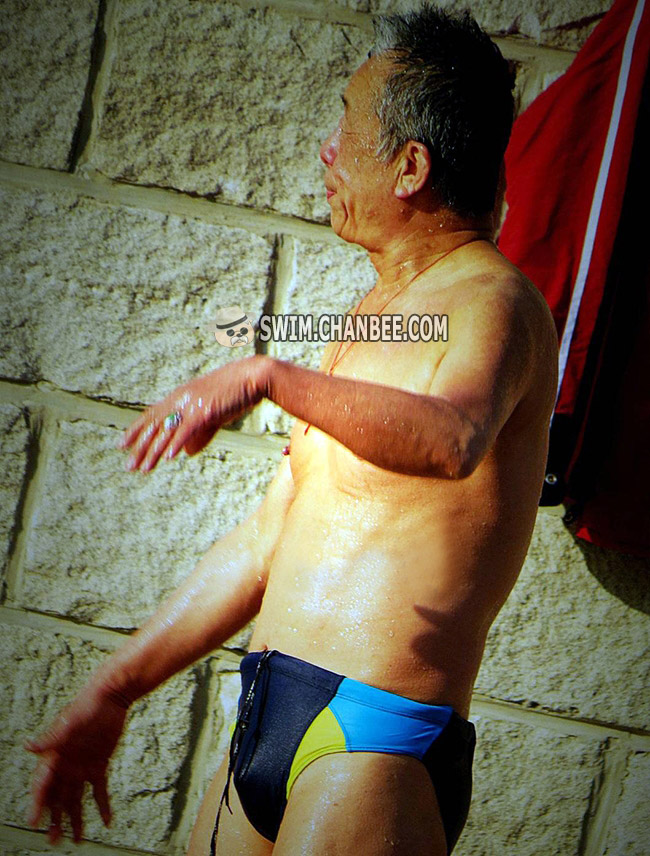 Swimming old man in a color underwear bathing