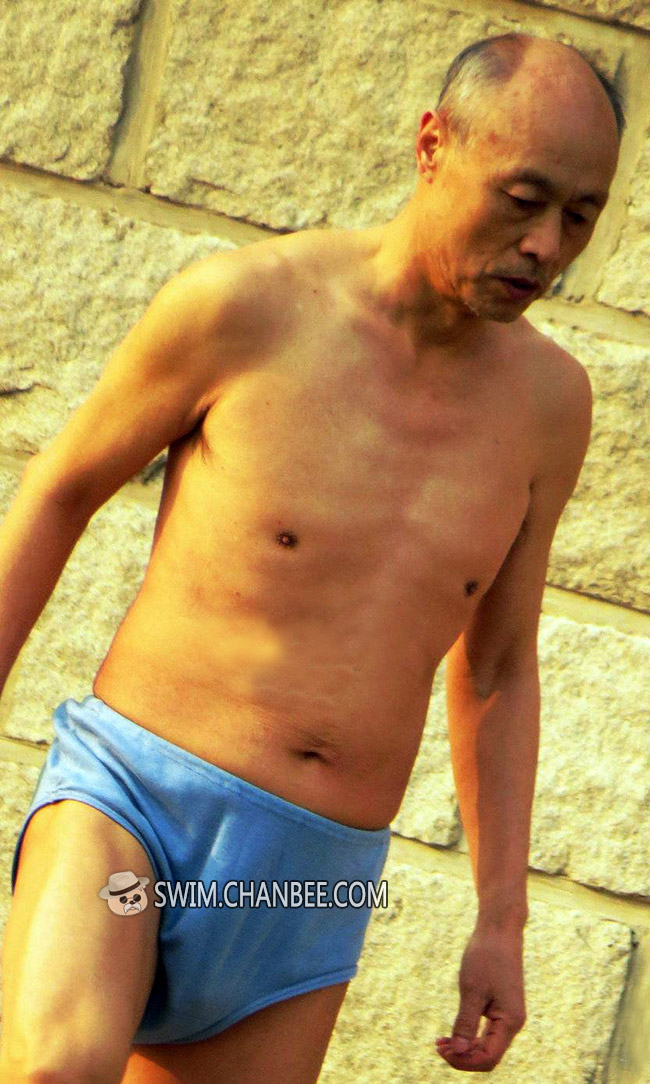 Thin swimming old daddy in a blue underwear doing exercise