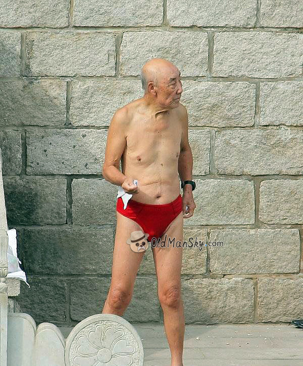 Old man in a red underwear wiping his body