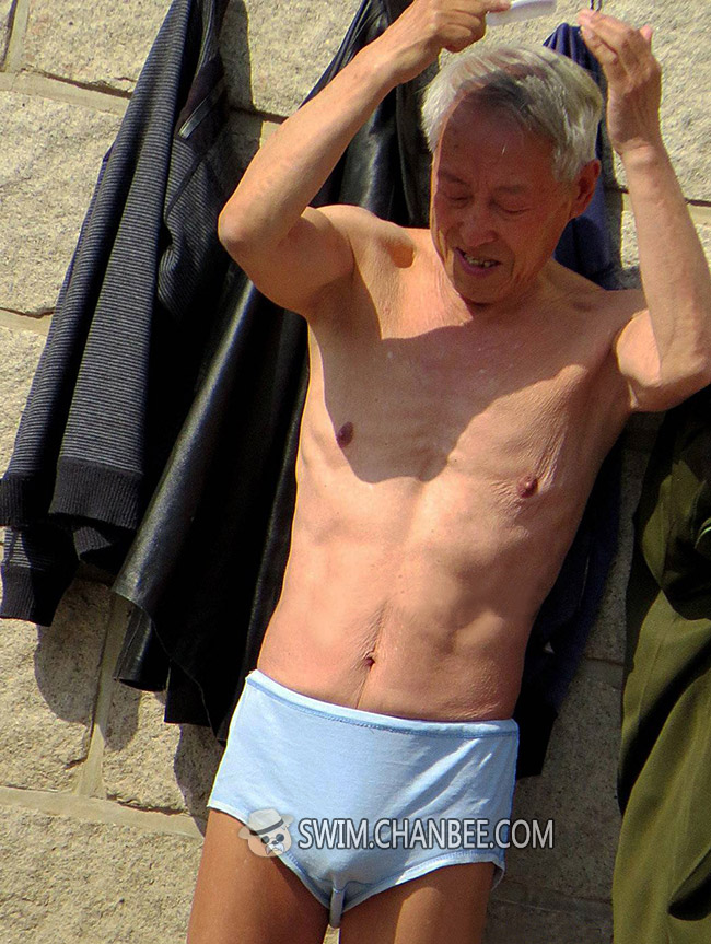 Silver hair swimming old man in a light blue underwear