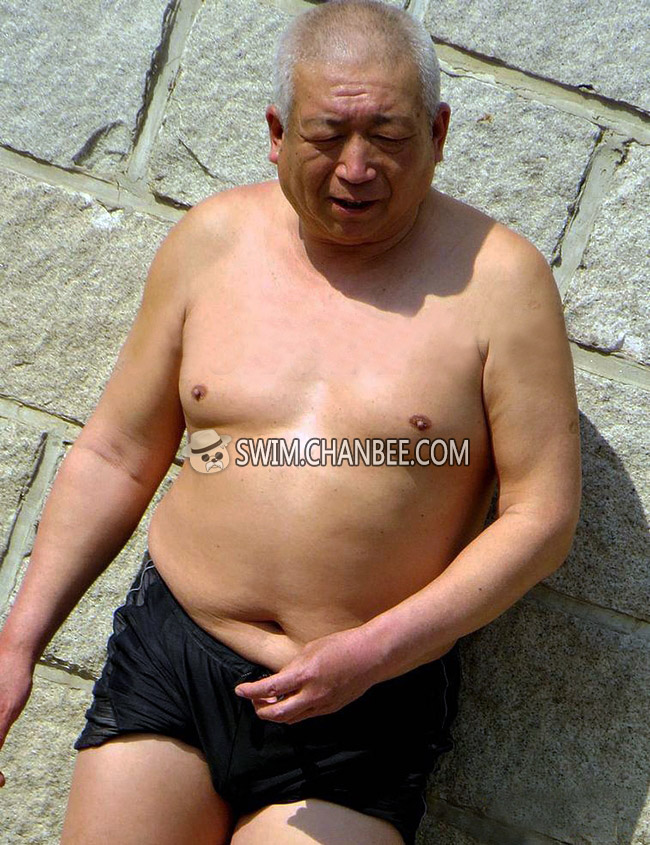 Chubby swimming old man in a black swim trunks