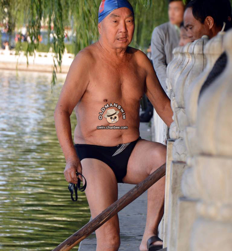 Old man in a black underwear out of lake