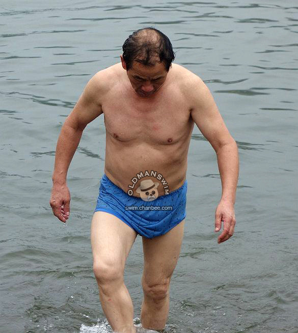 Old daddy in a spot blue underwear out of water