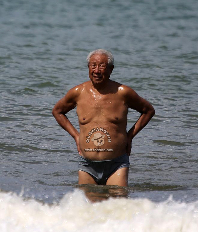 White hair grandpan in a gray underwear out of water