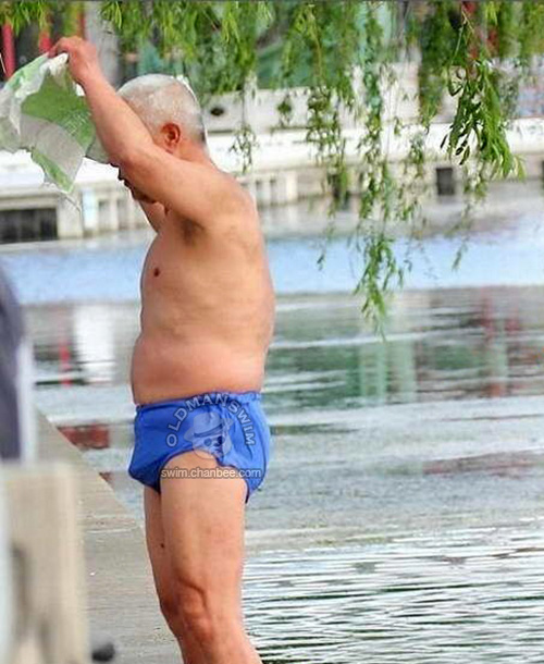 White hair old man in a blue underwear out of lake