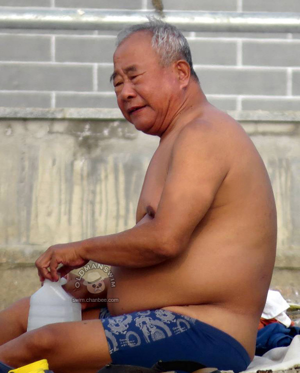 Chub belly old man in a blue swimsuit underwear go to swimming