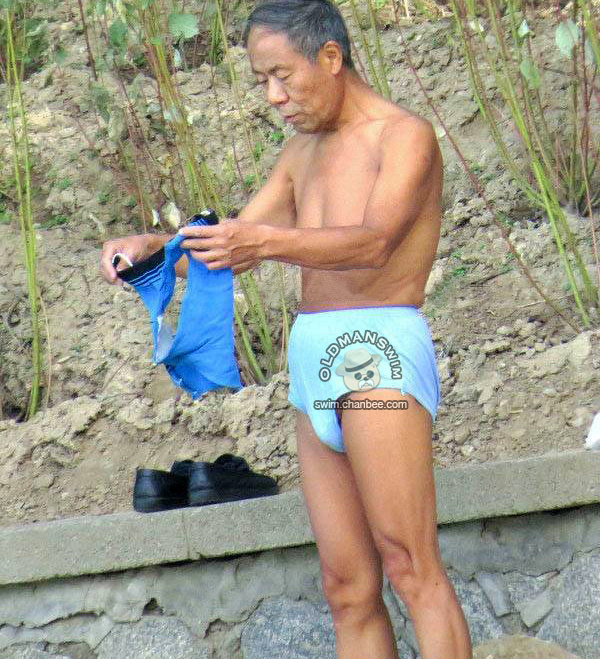 Swimming old man put on his deep blue underwear