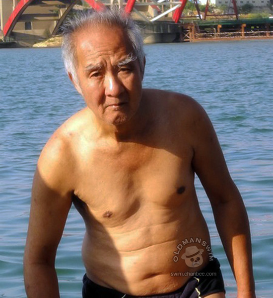 Silver hair old man in a black underwear bathing on bank of river