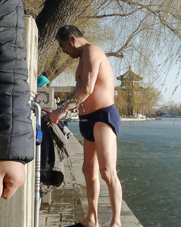 Swimming old daddy dressing on the bank of lake