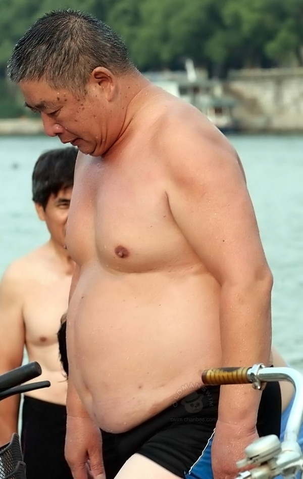 Fat swimming daddy changing his underwear by river