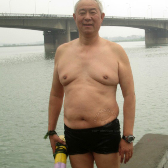 White hair kindly swimming old man in a black swimsuit