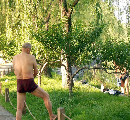 Two old men in pants by the river