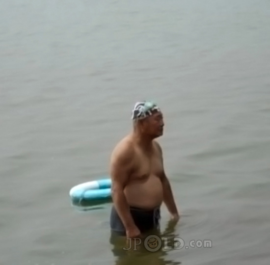 Chub swimming old daddy in black underwear out of river