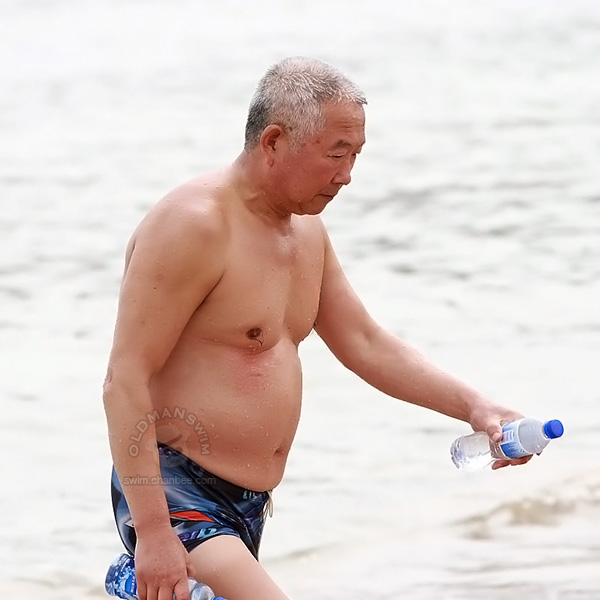 Fat old daddy in figure underwear out of water