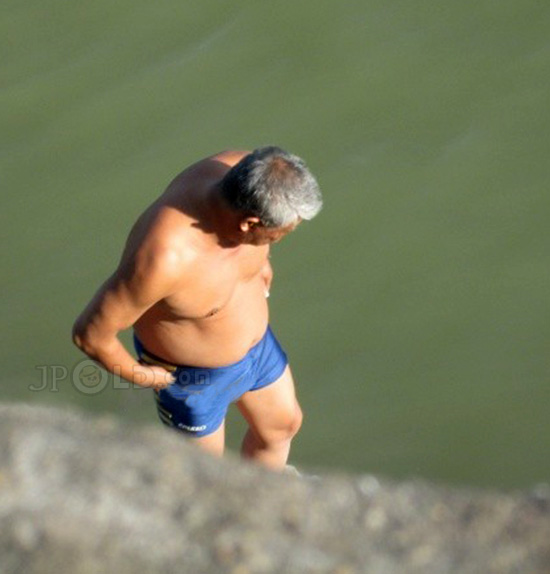 Two old man in blue underwears at the lake